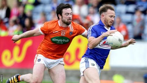 Armagh's Aidan O'Rourke challenges Paul Cahillane at O'Moore Park