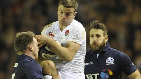 England's George Ford catches the ball under pressure from Stuart Hogg and Tommy Seymour