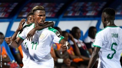 Inter Milan forward Keita Balde celebrates scoring for Senegal