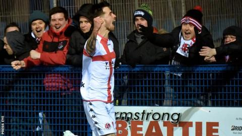 Declan Caddell celebrates with Crusaders fans after scoring against Ards