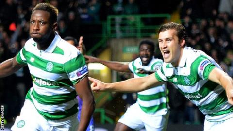 Celtic's Moussa Dembele and Erik Sviatchenko celebrate against Manchester City