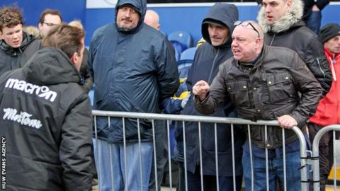Graham Westley argues with fan