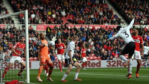 Middlesbrough goalkeeper Darren Randolph reacts to keep out Swans defender Martin Olsson's first-half header