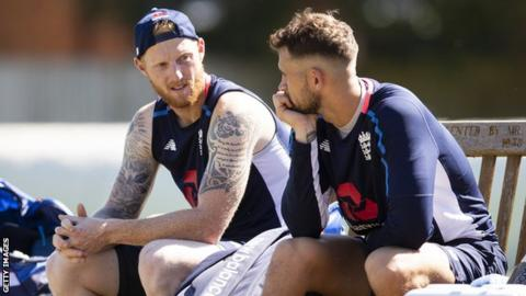 England cricketers Ben Stokes (left) and Alex Hales (right) talk while sat on a bench during a break in practice