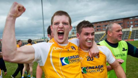 Owen Gallagher celebrates with Paddy McBride after Antrim's sensational win