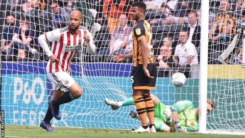David McGoldrick celebrates scoring his first goal against Hull City