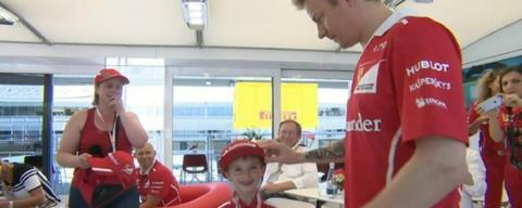 Kimi Raikkonen meets a young Ferrari fan