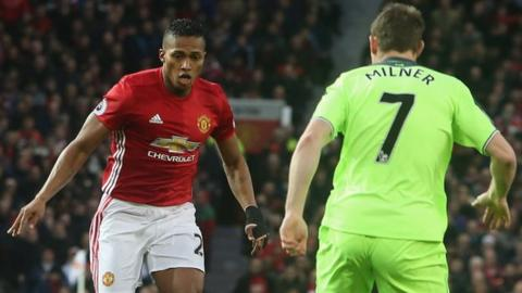 Antonio Valencia of Manchester United and James Milner of Liverpool