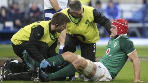 Ireland flanker Josh van der Flier receiving treatment at the Stade de France on Saturday