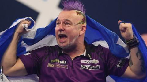 Peter Wright celebrates winning the PDC World Championship