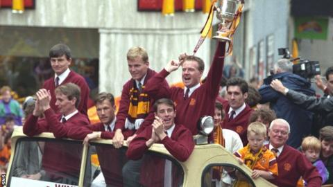 Motherwell players parade the Scottish Cup on an open-top bus after their 1991 triumph