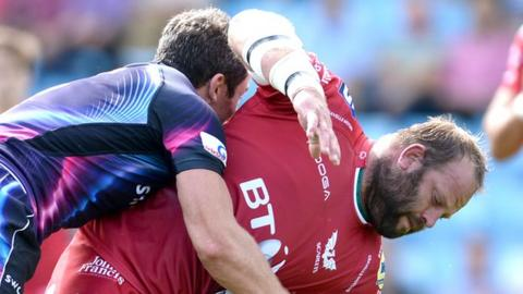 Ian Whitten tackles Peter Edwards