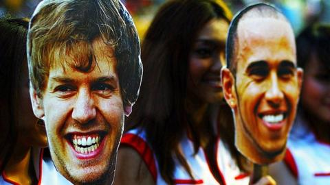 Sebastian Vettel and Lewis Hamilton masks