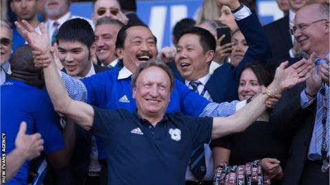 Neil Warnock and Vincent Tan celebrate