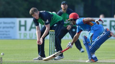 Najibullah Zadran attempts to avoid being run-out by Ireland's Peter Chase in last Tuesday's game at Stormont