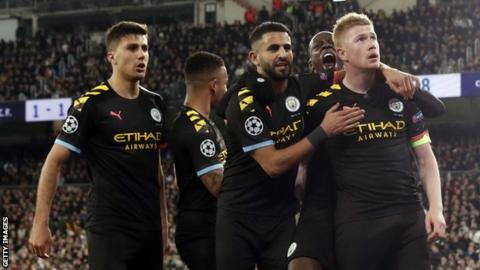Manchester City players celebrate a goal against Real Madrid