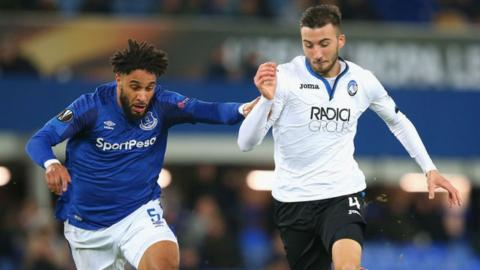 Ashley Williams and Atalanta's Bryan Cristante battle for the ball.