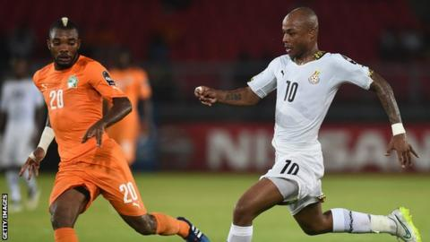 Serey Die of Ivory Coast challenges Ghana's Andre Ayew in the 2015 AFCON final