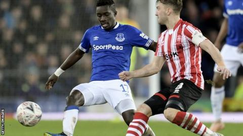 Everton midfielder Idrissa Gueye makes a challenge during the FA Cup third-round tie against Lincoln City