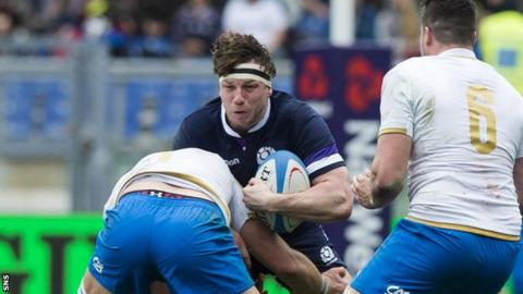 Hamish Watson in action for Scotland