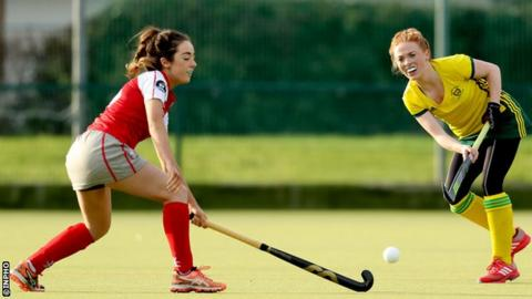 Katie McGee of Pegasus attempts to block a pass from Railway Union's Anna May Whelan