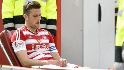 Hamilton Accies' Michael Devlin is helped off the park against Dundee