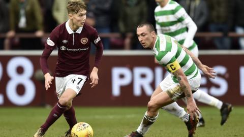 Hearts' Harry Cochrane takes on Celtic's Scott Brown