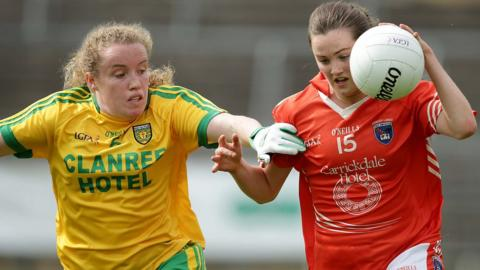 Donegal's Kate Keeney attempts to halt the progress of Armagh opponent Aimee Mackin at St Tiernach's Park