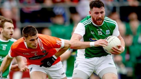 Armagh's Gregory McCabe puts pressure on Fermanagh forward Seamus Quigley in the Ulster SFC game