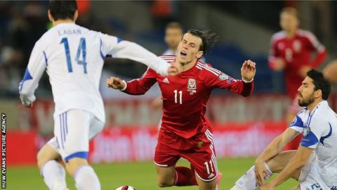 Gareth Bale is brought down by Cyprus midfielder Marios Nikolaou