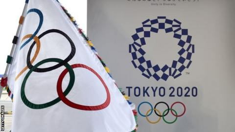 An Olympic flag and the logo of the Tokyo 2020 Games