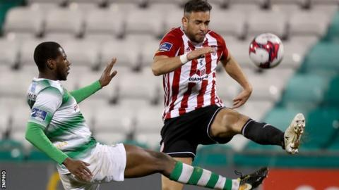 Rovers striker Dan Carr puts a challenge in on Derry's Darren Cole in Friday night's game