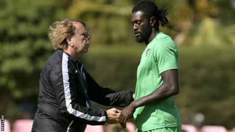 Togo coach Claude LeRoy and captain Emmanuel Adebayor