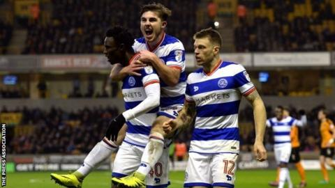 QPR debutant Ryan Manning (centre) and Jamie Mackie (right) helped celebrate Idrissa Sylla's goal at Molineux