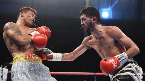 Andrew Selby lands with a body shot against Ardin Diale