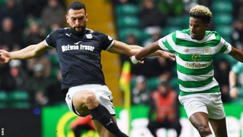 Steven Caulker battles for possession with Celtic's Scott Sinclair