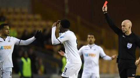 Swansea players protest red card