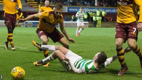 Callum McGregor appeals for a penalty after a challenge from Motherwell's Andy Rose