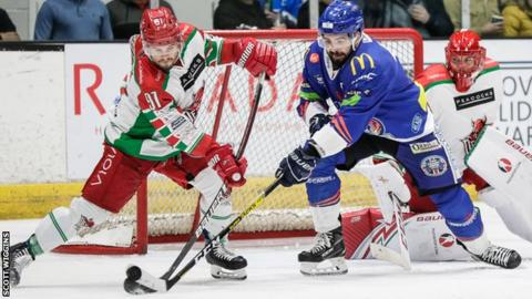 Bryce Reddick (L) battles for the puck