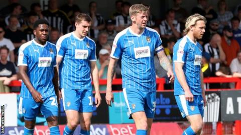 Notts County players look dejected after conceding an equaliser at Crawley