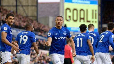 Richarlison celebrates Everton's opening goal against Chelsea