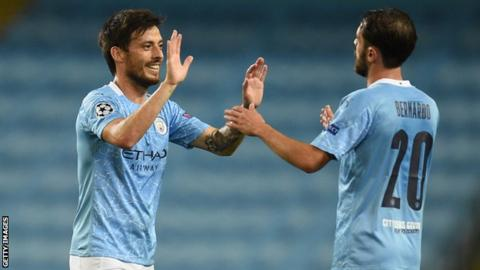 David Silva high fives a Manchester City team-mate