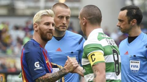 Lionel Messi and Scott Brown