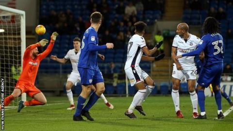 Armand Traore fires the ball past Ben Alnwick in the Bolton goal