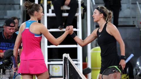 Karolina Pliskova and Victoria Azarenka shake hands at the net after their second round Madrid Open tie