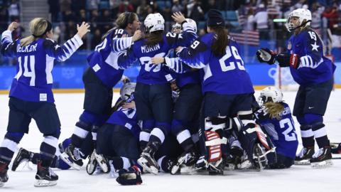 Usa celebrate beating Canada in ice hockey final