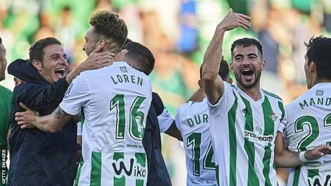 Real Betis celebrate qualifying for the 2018-19 Europa League after beating Sevilla in May
