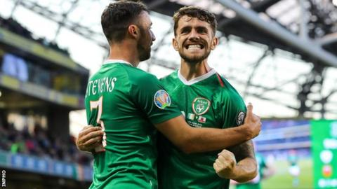 Robbie Brady celebrates his goal with Enda Stevens