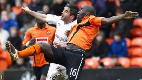 Morgaro Gomis, right, has played 166 games for Dundee United across two spells