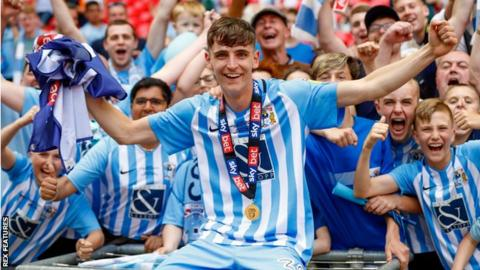 Tom Bayliss celebrates promotion with Coventry